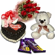 Send Delicious Cake 1kg Fresh Flowers Teddy and Chocolates for Birthday gifting