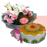 Buy Fresh Fruits Cake half kg with Assorted Flower bunch of Lily and Carnations paper Packed