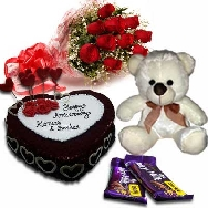 Send Delicious Red Velvet Designer Cake 1kg Fresh Flowers Teddy and Chocolates for Birthday gifting