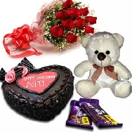 Send Delicious Heart Shape Chocolate Cake 1kg Fresh Flowers Teddy and Chocolates for Birthday gifting