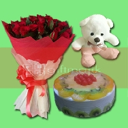 Send Beautiful bunch of 20 Red Roses with Fresh Fruits Cake and good quality Teddy size 6 inches