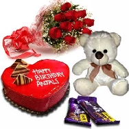 Send Delicious Strawberry Heart shape Cake 1kg Fresh Flowers Teddy and Chocolates for Birthday gifting